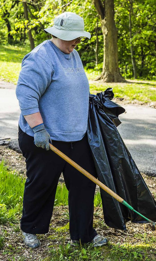 Cindy Muschall has her bag and pick up stick to do battle with some garbage
