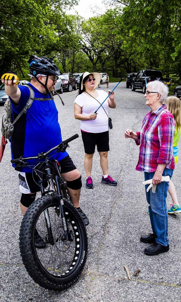 Sharon Babbitt deep in conversation with The head of the Bike and Trail group who is currently forging recreational trails in Fairmount Park