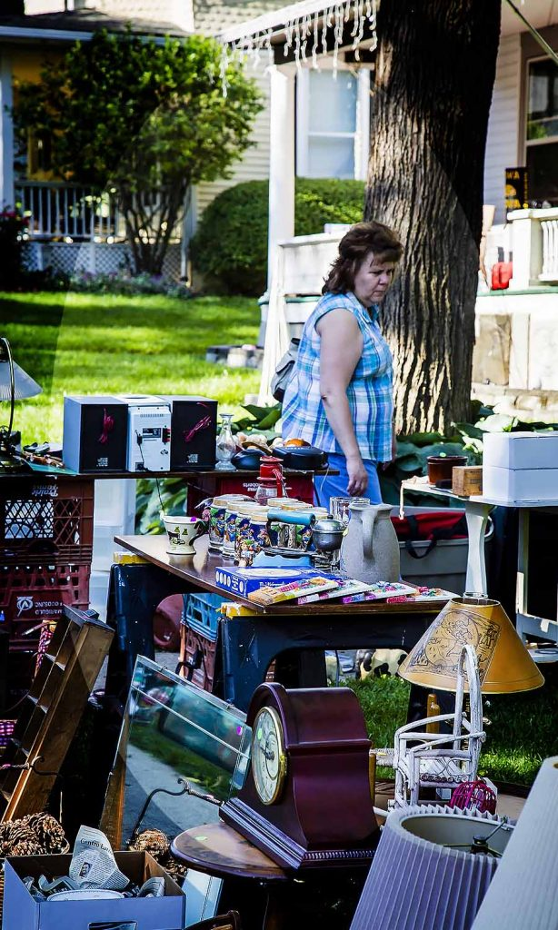 An early morning shopper reviews the wares at Rick and Sarah Shively (406 Glen Avenue)