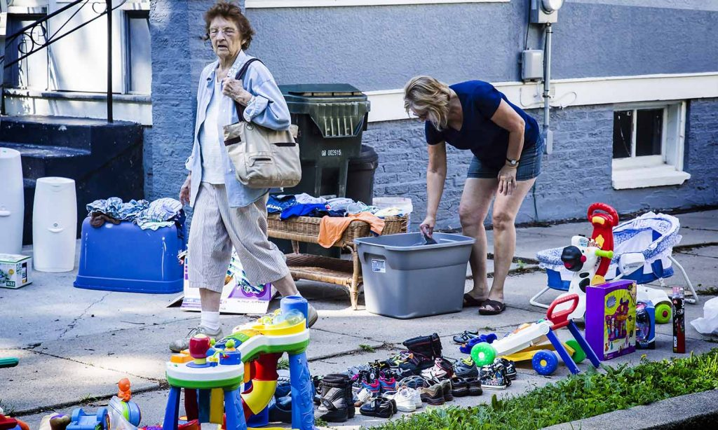 Mary Aney (199 Test Street) rummages thru the bins at the Gorman's Sale
