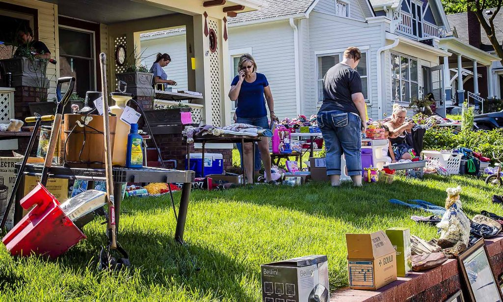 Jon and Maureen Garrigan (433 Glen Avenue) have the porch, lawn and sidewalk filled with items up for sale