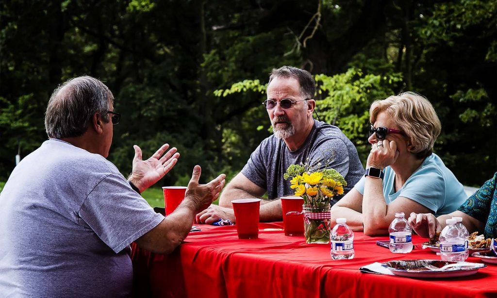 Greg, Dave Huggins and Vicki enjoy a conversation after a good meal