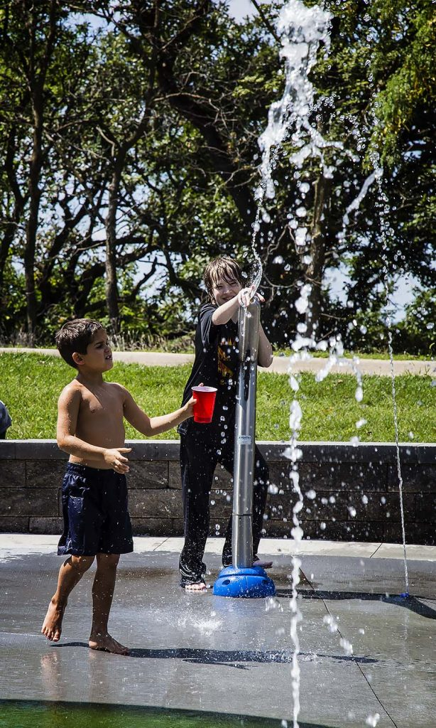 Matthew and Allan Hanson enjoy the splash pad and water cannons