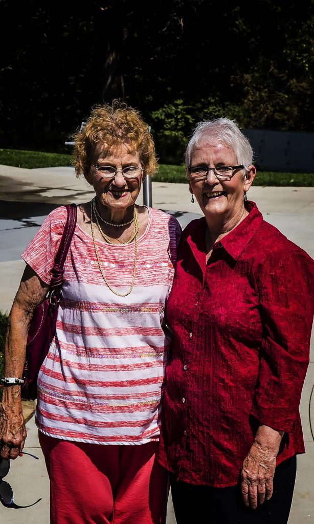 Maxine Gotto and Sharon pose as the picnic starts to break up. Maxine has moved away but still enjoys catching up with her friends